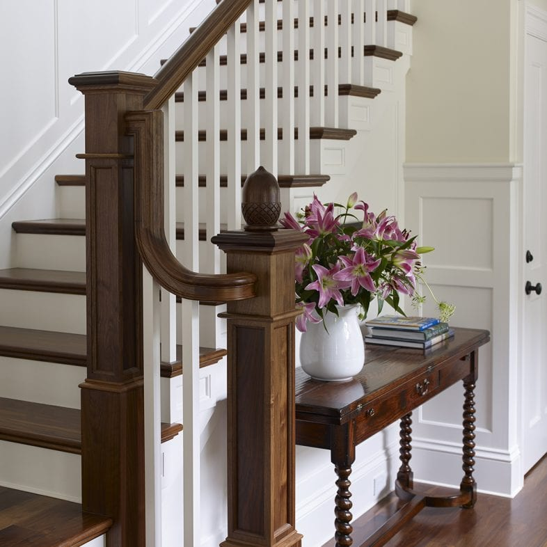 Contrasting dark wood with bright white painted stairs at the Summer Haven property
