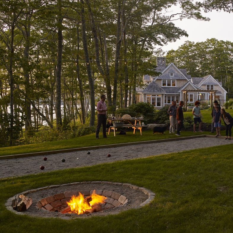 Outdoor recreation area, built-in play area and firepit with stone detailing.