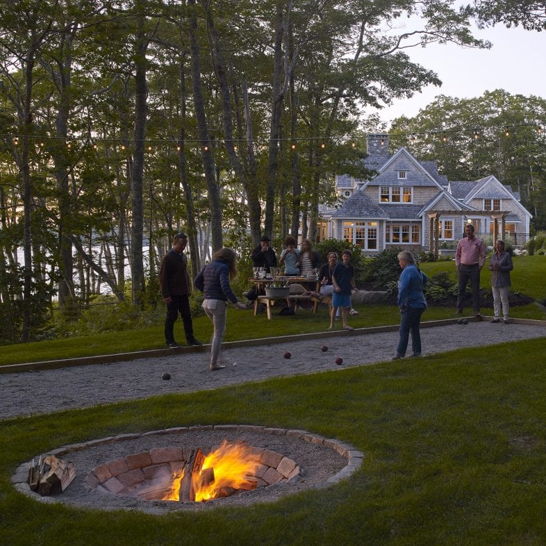 Outdoor recreation area with sunk-in fireplace.