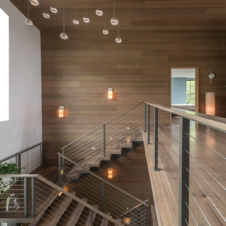 A view of the contemporary staircase and loft-style upstairs at Tides Ledge