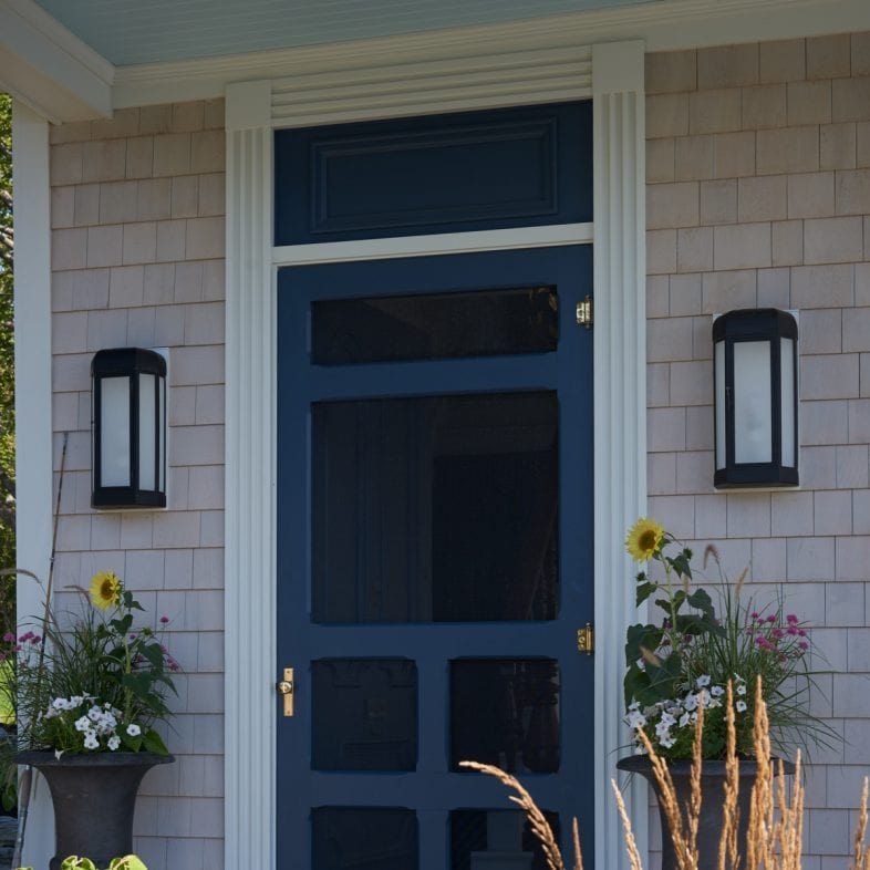 Welcoming entryway with coastal theme and floral accents.