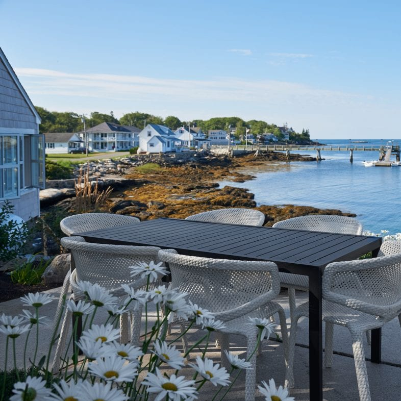 Open patio with floral and coastal views along Twin Cove.