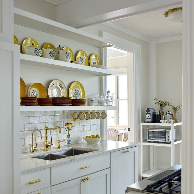 Gold and marble details continue throughout this coastal Maine kitchen.