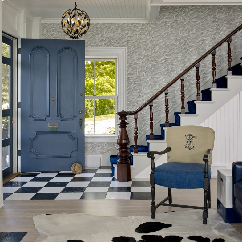 Staircase leading to the entryway with unique theme.