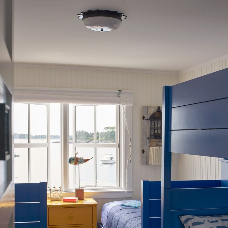 Bunked up bedroom with cute fishing theme that overlooks the ocean in Maine.