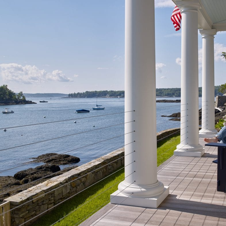 Twin Cove front porch with comfortable seating that overlooks the ocean in Maine