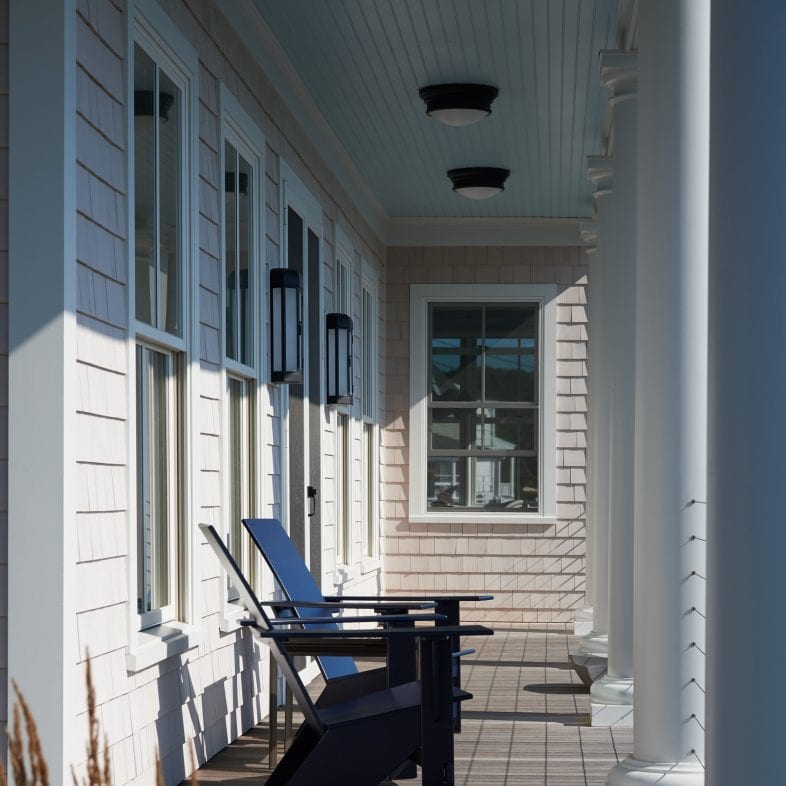 Twin Cove porch with luxury adirondack chairs and wood side detailing.