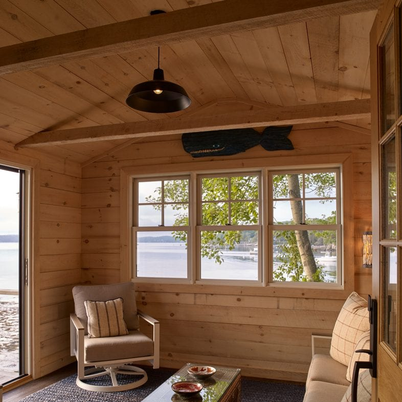 A view of the living space at the Umami Point guest house, with coastal views.