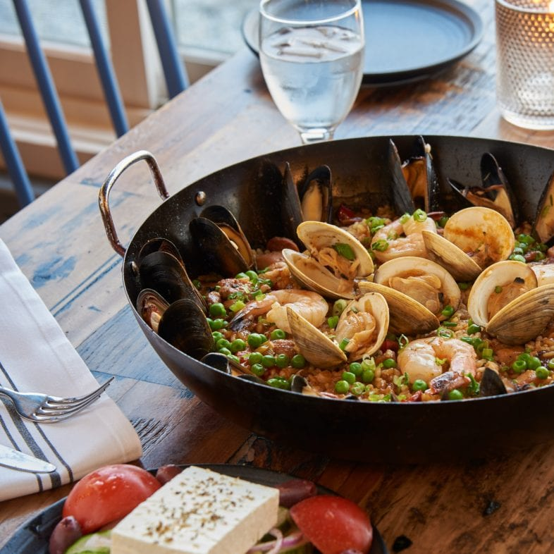 Seafood dinner with wine on the rustic tables at Water Street