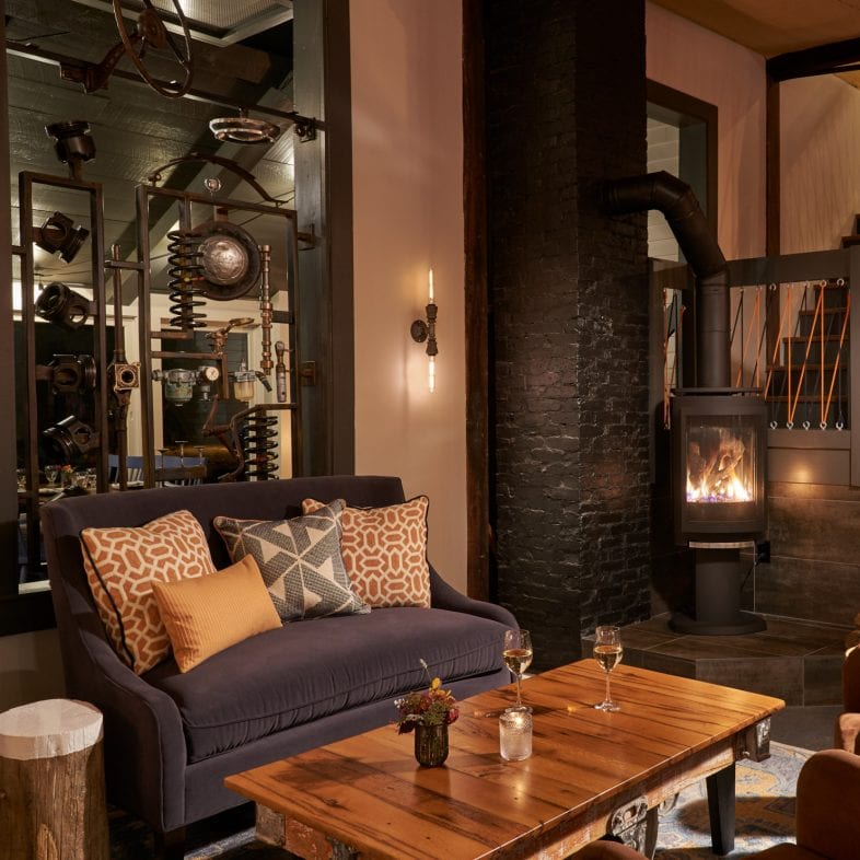 Cozy lounge area at Water Street with unique fireplace.