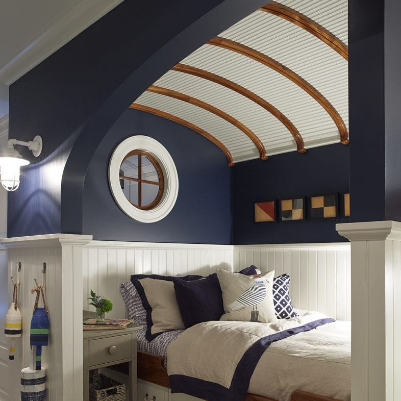 Nautical inspired room with navy blue and shiplap ceiling