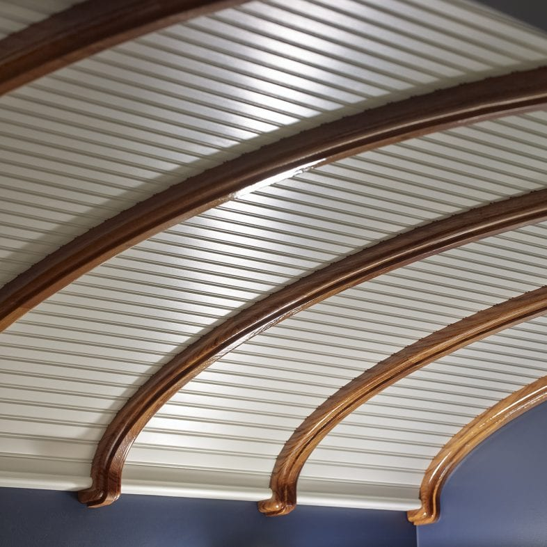 Close-up of nautical inspired ceiling with nickel gap shiplap and wood beams