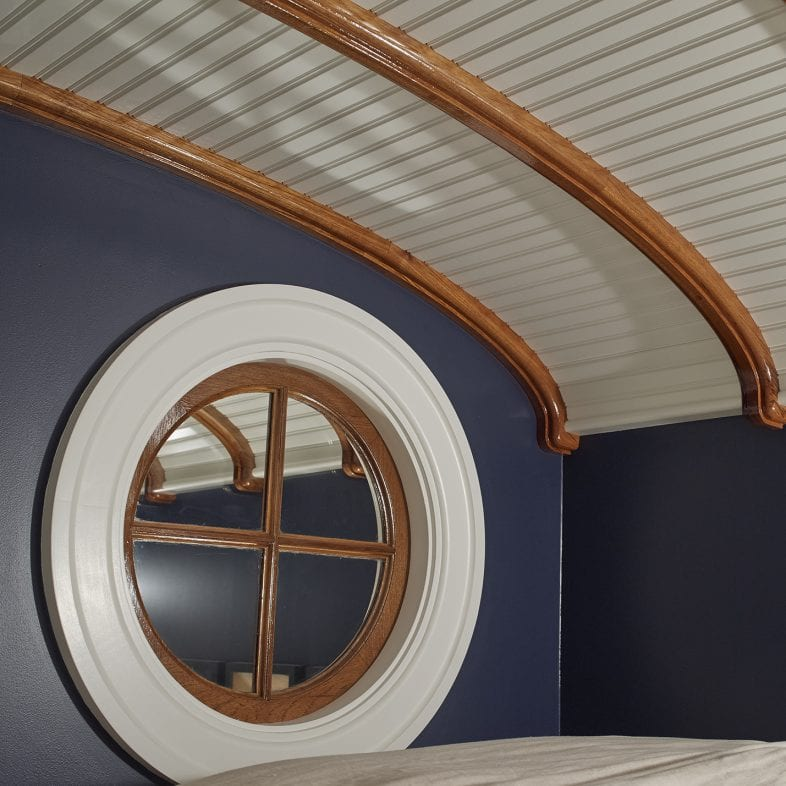 Bright white ceiling with polished wooden detailed arches and nautical theme at Whales Watch