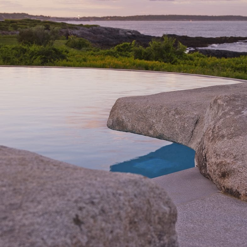 Pool at Whales Watch with stone to make seemless views throughout coastline