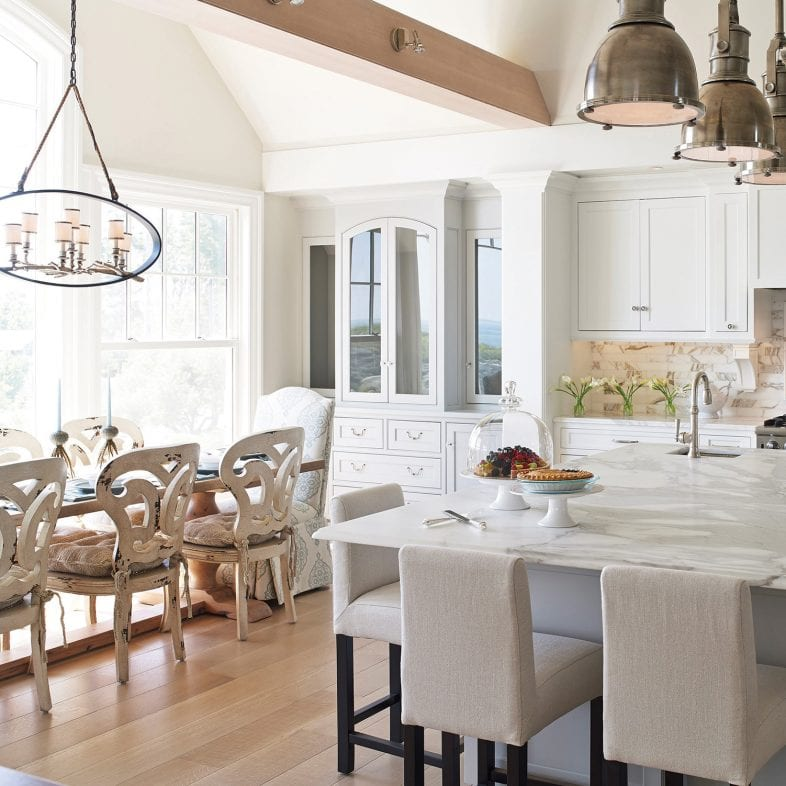 Large kitchen and dining area with built-in cabinetry and white marble details