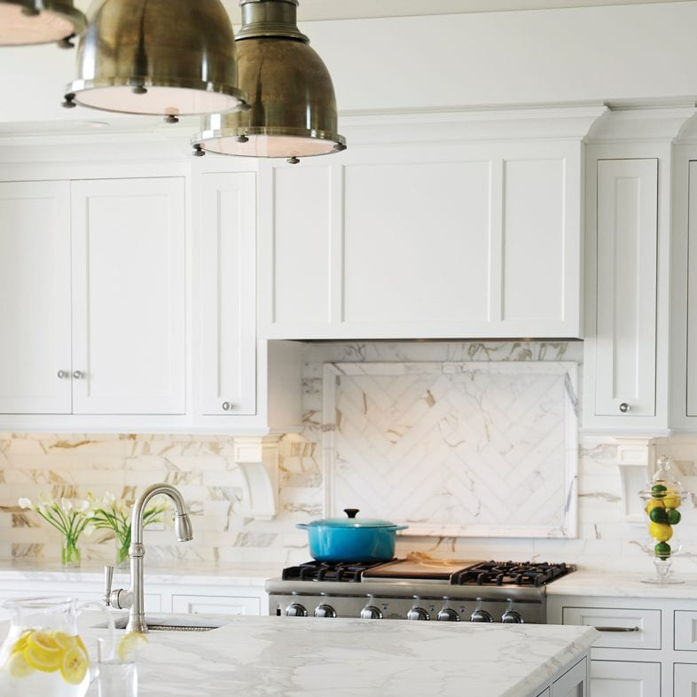 Bright white kitchen with unique marble tiled backsplash and countertop at Whales Watch