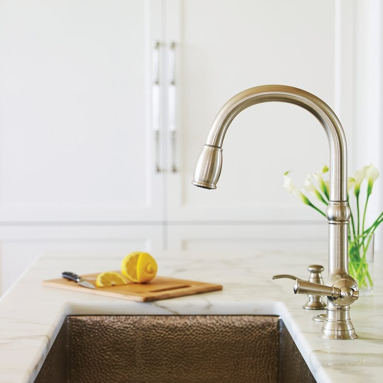 A modern, sleek silver faucet with hammer finish basin and marble countertops in the kitchen at Whales Watch