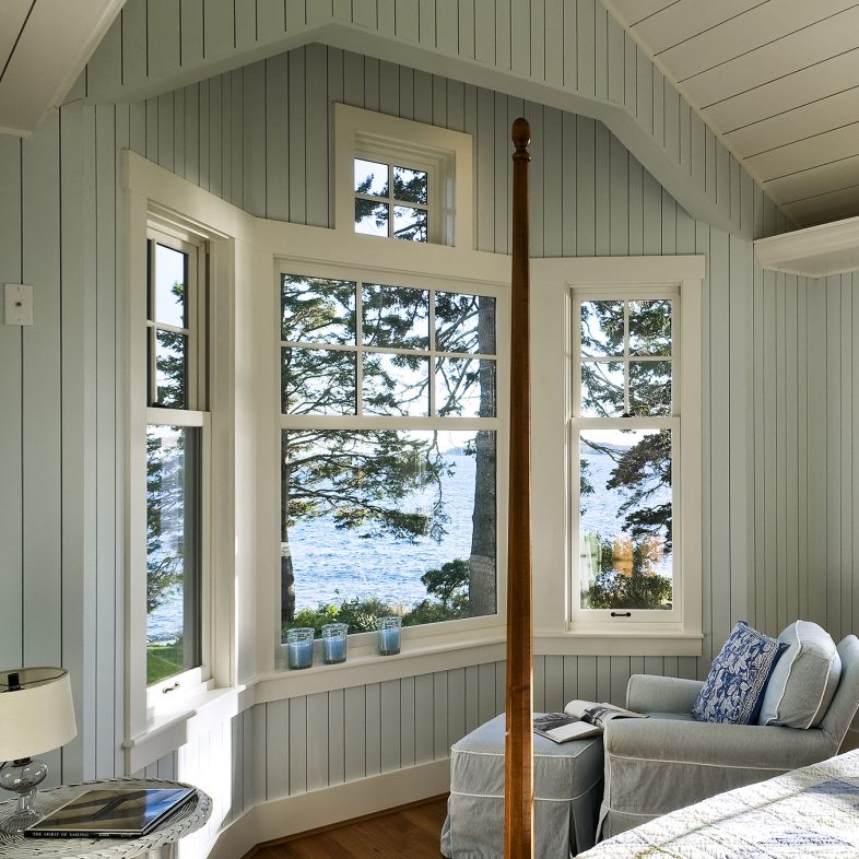 Maine cottage style bedroom with water views at Grandview