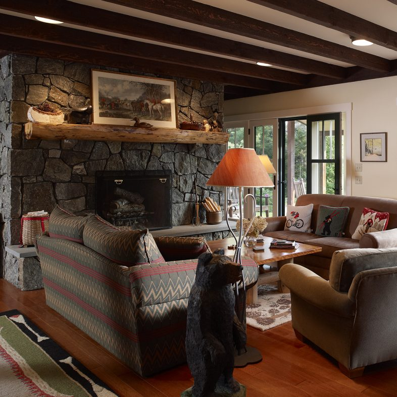 Cozy living room with large stone fireplace at Grass Roads Farmhouse