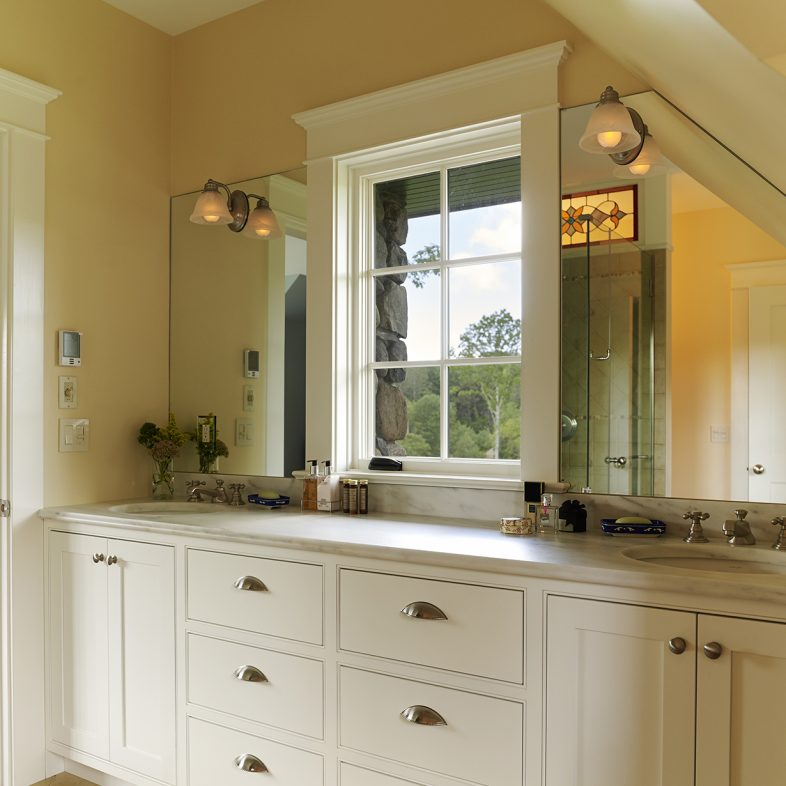 Double vanity with a window in the master bathroom at Highfields