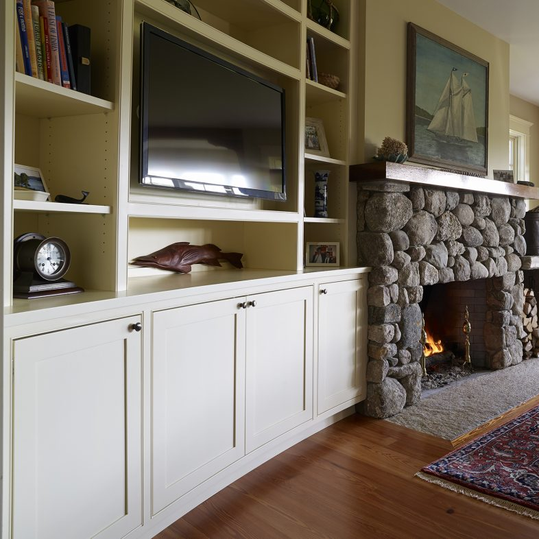 Built ins next to the fireplace in the living area at Highfields