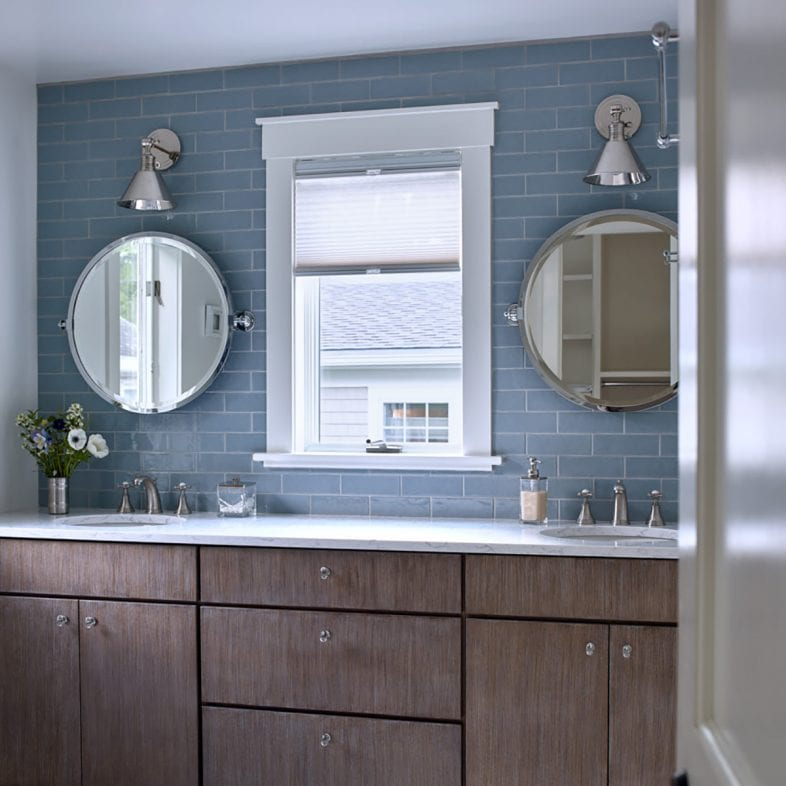 Blue bathroom with double vanities at Casino Cottage