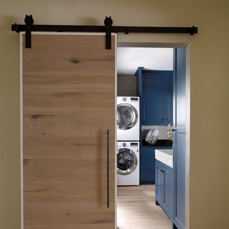 Sliding barn door to the laundry room at Casino Cottage