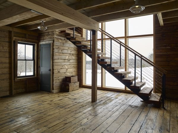 Rustic and cabin-inspired stair with large picture windows