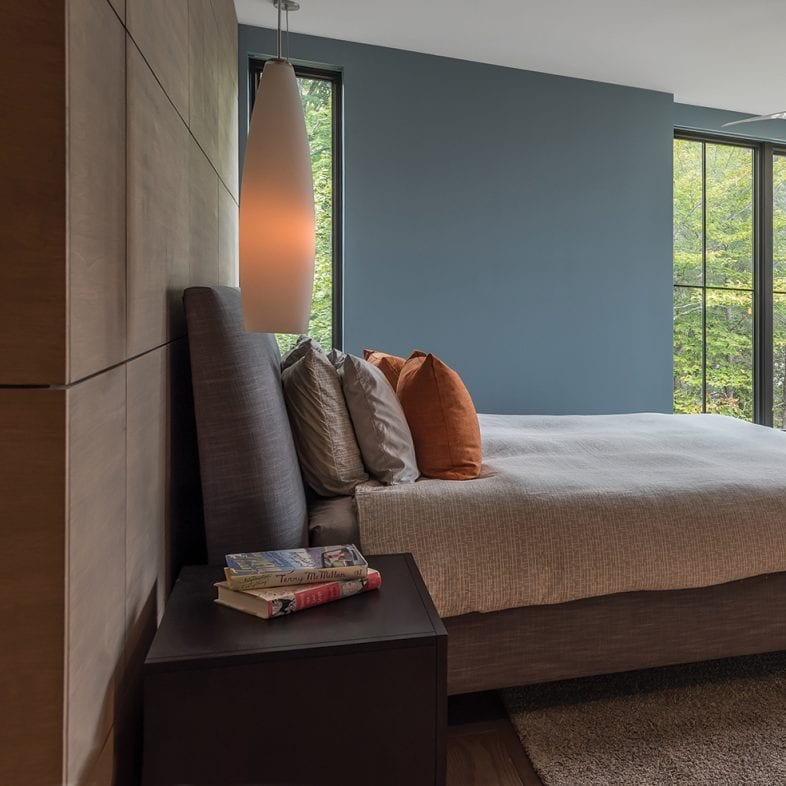 A spacious master bedroom loaded with natural light and contemporary style.