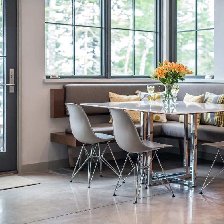 Bench seats and bucket seats for this contemporary kitchen dining area.