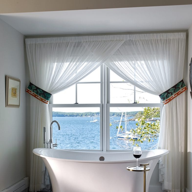 The bathtub with wine holder in the master bathroom with views of the coast at Umami Point.